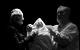 "<div class=""normal"">Хозяйка в квартире Башмачкина; жена Григория Петровича &mdash; Юлия Чебакова<br />Григорий Петрович; Будочник &mdash; Валерий Хлевинский</div><div class=""small it normal"">Фото: Екатерина Цветкова</div>"